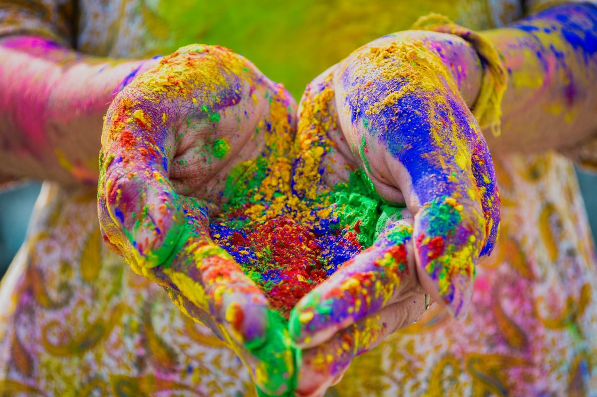 Person S Hand Full Of Colored Powder